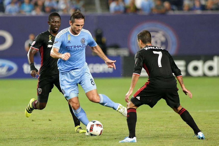 NYCFC midfielder Frank Lampard plays the ball while being defended by D.C. United midfielder Marcelo Sarvas during a game. Lampard is leaving the football club when his contract expires at the end of the year.