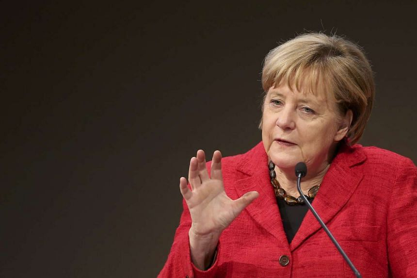 German Chancellor Angela Merkel has urged Germans to be open-minded, warning that Donald Trump's victory could inflame Germany's refugee debate.