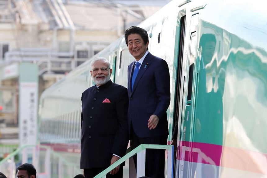 Indian Prime Minister Narendra Modi and Japanese Prime Minister Shinzo Abe leave a Shinkansen bullet train during a visit to a Kawasaki Heavy Industries plant in Kobe, Japan.
