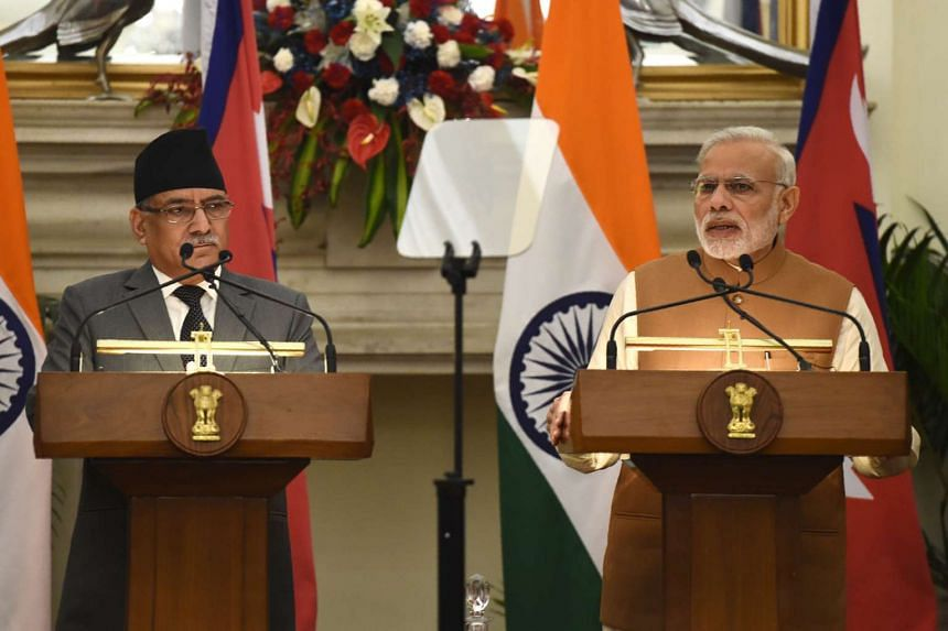 Indian Prime Minister Narendra Modi (right) speaks during a joint press conference with Nepalese Prime Minister Pushpa Kamal Dahal in New Delhi on Sept 16, 2016.