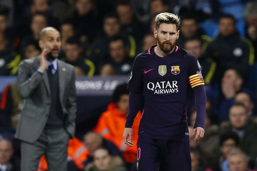 Manchester City manager Pep Guardiola and Barcelona's Lionel Messi during a UEFA Champions League match on Nov 1, 2016.