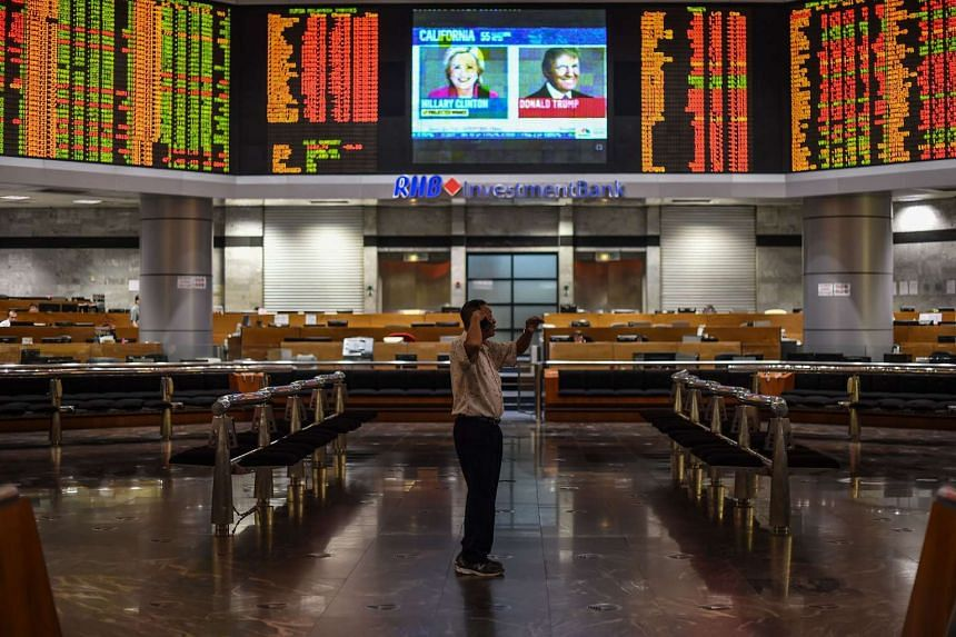 Electronic boards showing stock movements on the final day of the US presidential election at a private stock exchange in Kuala Lumpur.