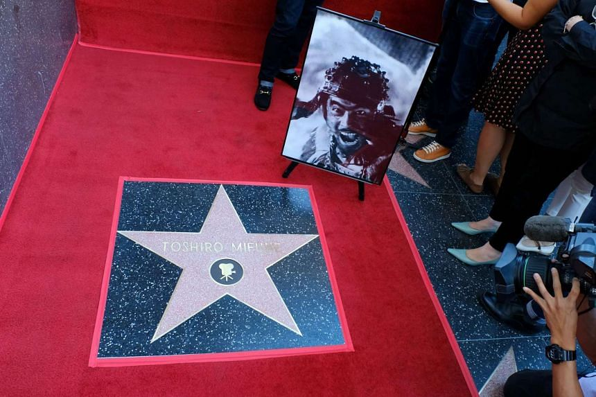 A photo of the late Japanese actor Toshiro Mifune is seen next to his Hollywood star.