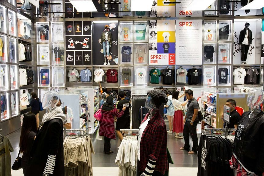 People shopping at a Uniqlo store in Singapore on Sept 16, 2016.