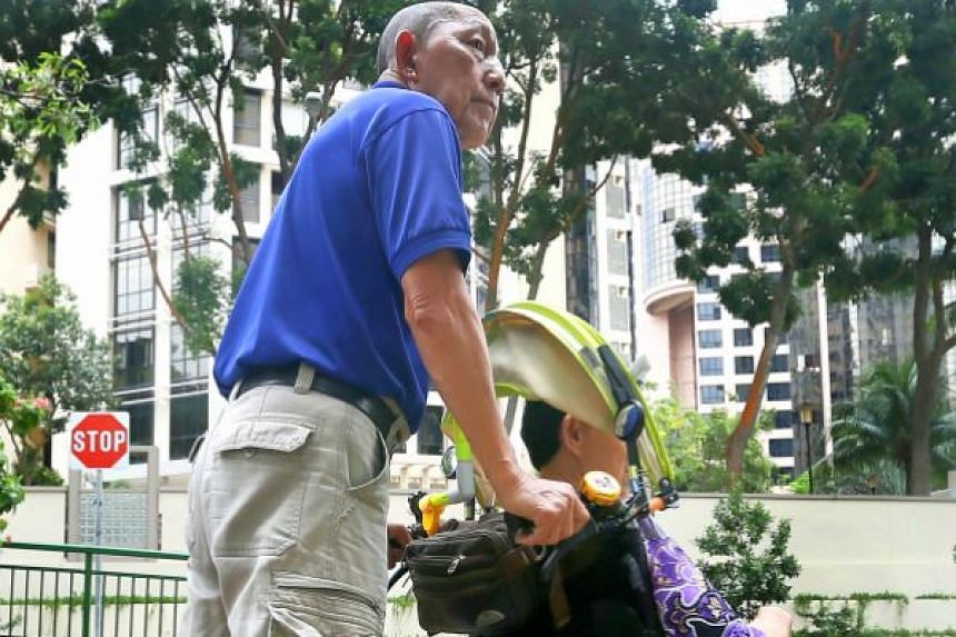 Mr Tan Ban Ho with the wheelchair he uses to push his wife, Madam Loh Yock Yeng, around Singapore.