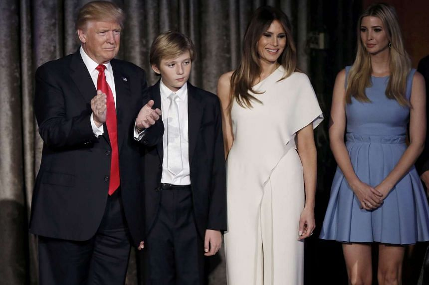 US President-elect Donald Trump (left) greets supporters along with his wife Melania (second from right) and children during his election night rally in Manhattan, New York on Nov 9, 2016.