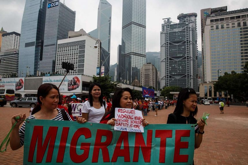 Domestic helpers in Hong Kong marched in protest on September 4 after several maids fell to their death from tower block windows as they tried to clean them.