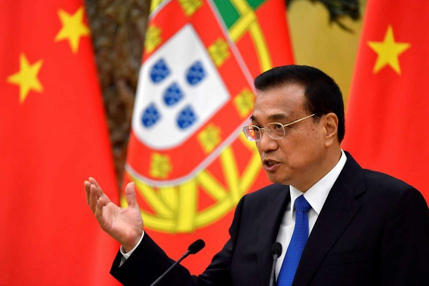 Chinese Premier Li Keqiang speaks during a joint news conference with Portuguese Prime Minister Antonio Costa at the Great Hall of the People in Beijing.