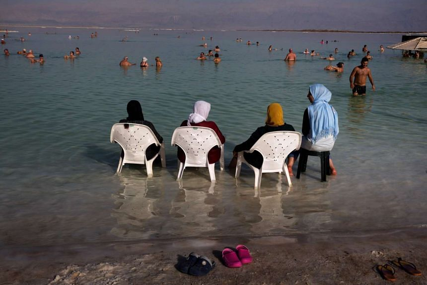 Muslims and other tourists hang out at the resort of Neve Zohar in the southern part of the Dead Sea, on Oct 15, 2016.