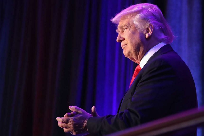 US President-elect Donald Trump acknowledges the crowd during his election night event at the New York Hilton Midtown on Nov 9, 2016.