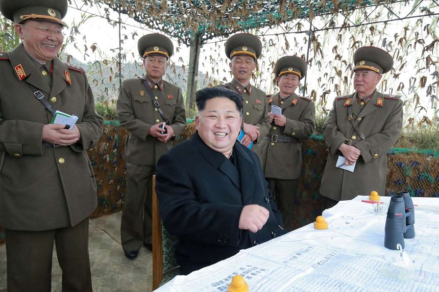 North Korean leader Kim Jong Un inspects a defence detachment in a photo released on Nov 11, 2016.