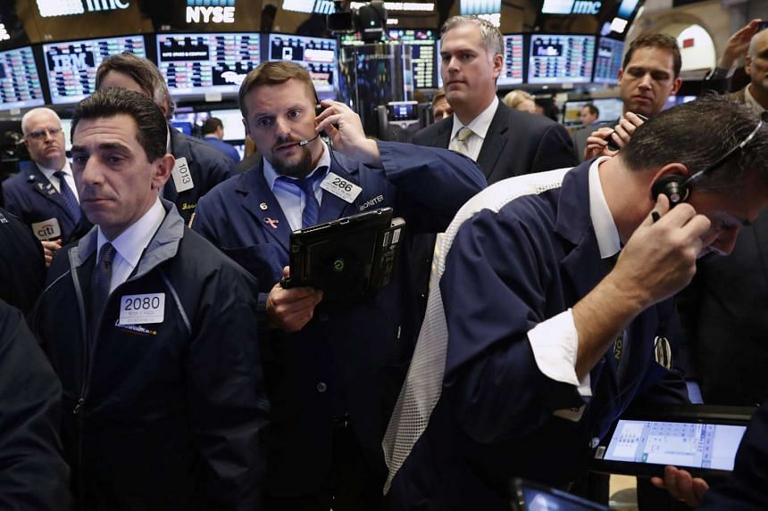 Traders work on the floor of the New York Stock Exchange shortly after the opening bell on Nov 15, 2016.