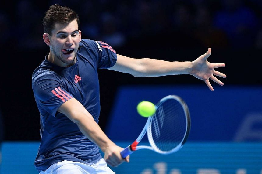 Austria's Dominic Thiem returns against France's Gael Monfils during their round robin stage men's singles match on day three of the ATP World Tour Finals tennis tournament in London on Nov 15, 2016.