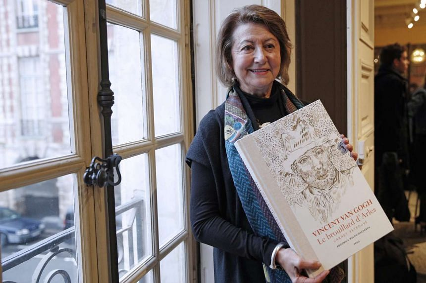 Canadian art historian and Van Gogh specialist Bogomila Welsh-Ovcharov poses with a copy of her book.