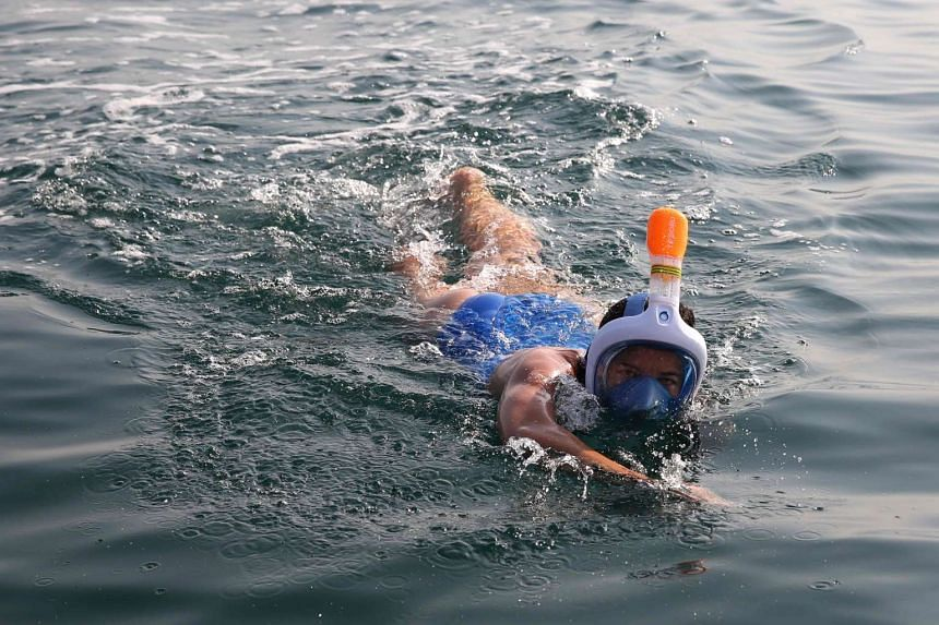 A participant takes part in a 18-kilometre swim from Jordan to Israel across the Dead Sea on Nov 15, 2016.