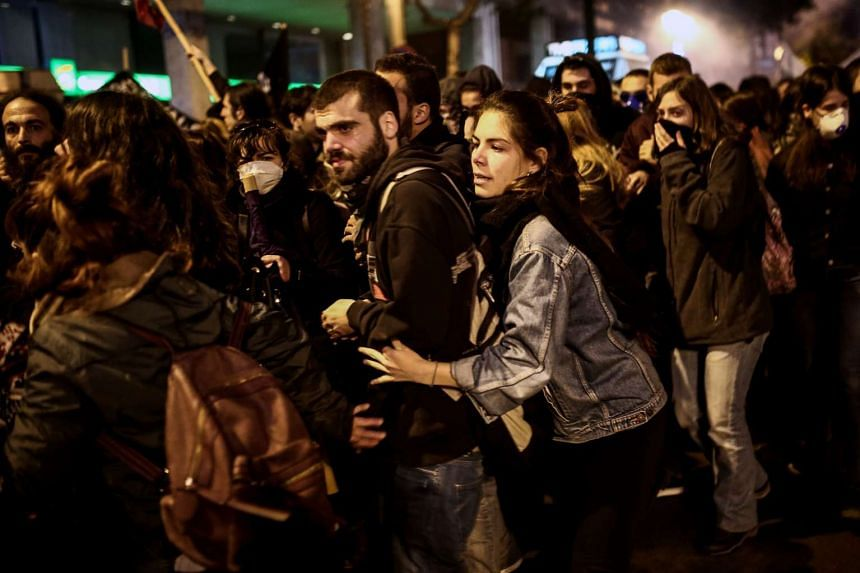 Protesters clash with riot police during the protest in Athens.