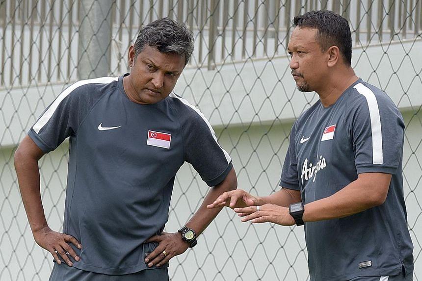 Coach Sundramoorthy and youth head coach Fandi Ahmad during training last month.