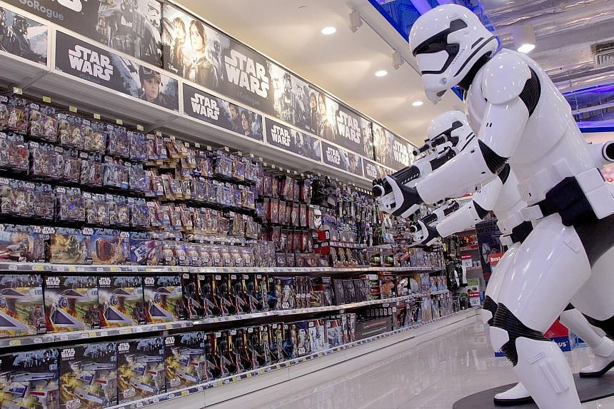 Sales of action figures, such as these in a Toys 'R' Us store at VivoCity, are expected to get a boost from upcoming movie releases such as Rogue One: A Star Wars Story.