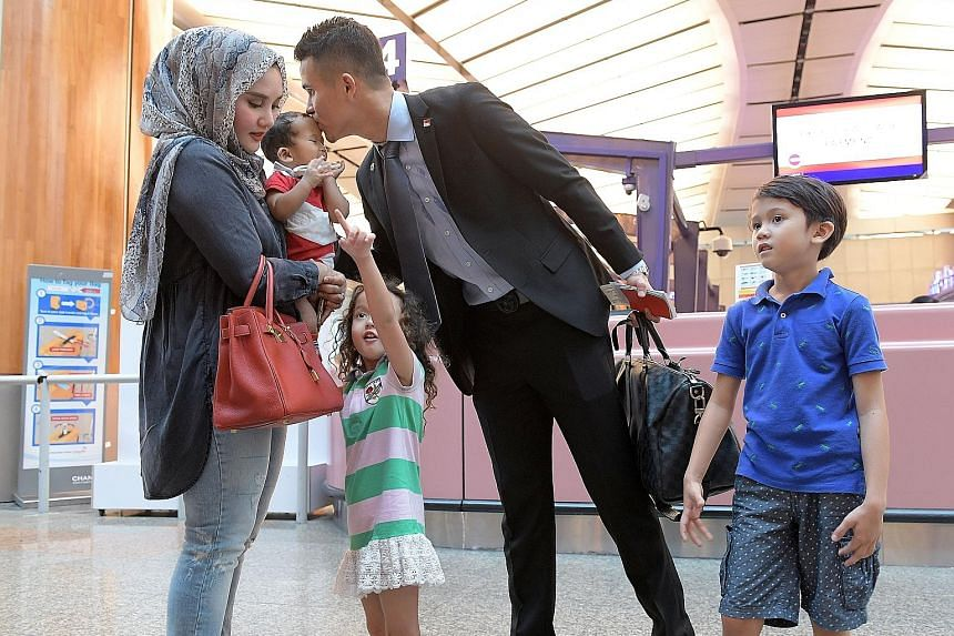 Defender Baihakki Khaizan bidding his family farewell at Changi Airport before flying to the Philippines for the AFF Suzuki Cup with the Lions. A veteran with three titles, he has called on his younger team-mates to give everything for the competitio