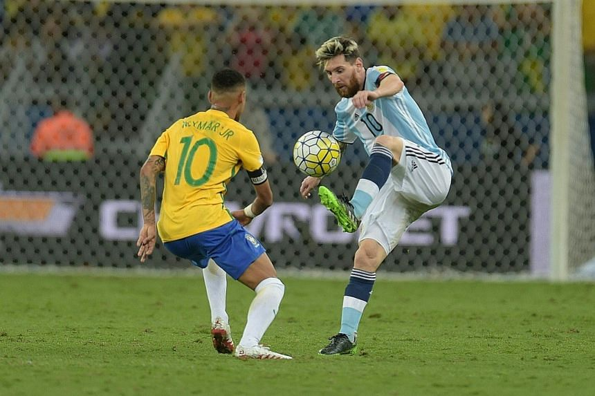 Argentinian star Lionel Messi trying to get past Brazil's Neymar, his Barcelona club mate, during their World Cup qualifier in Belo Horizonte last Thursday. Brazil won 3-0 to heap more pressure on their South American rivals, and anything less than a