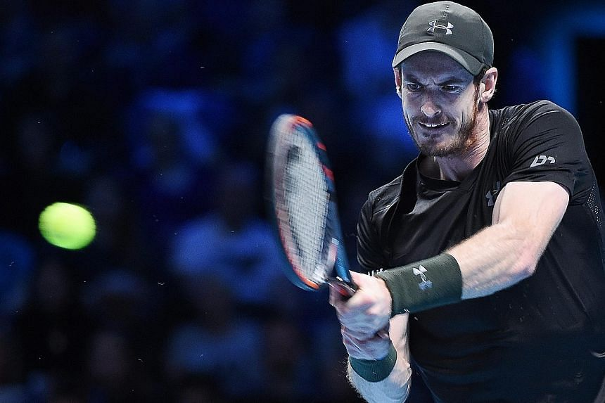Freshly-minted world No. 1 Andy Murray hitting a return during his 6-3, 6-2 straight-sets win over Marin Cilic of Croatia at the ATP World Tour Finals.