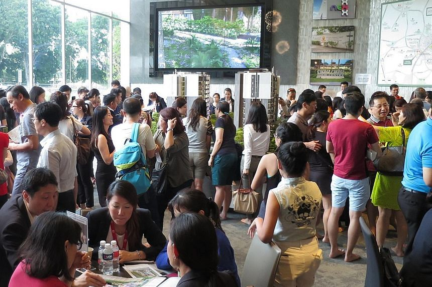 The crowd at the Forest Woods showflat in September. The project sold 364 units last month at a median price of $1,412 psf.