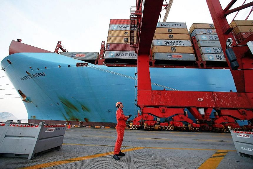 A worker at the Yangshan Deep Water Port in Shanghai, China. Analysts say that a trade war between China and the US will hurt not only the nations' ties but also regional economies.