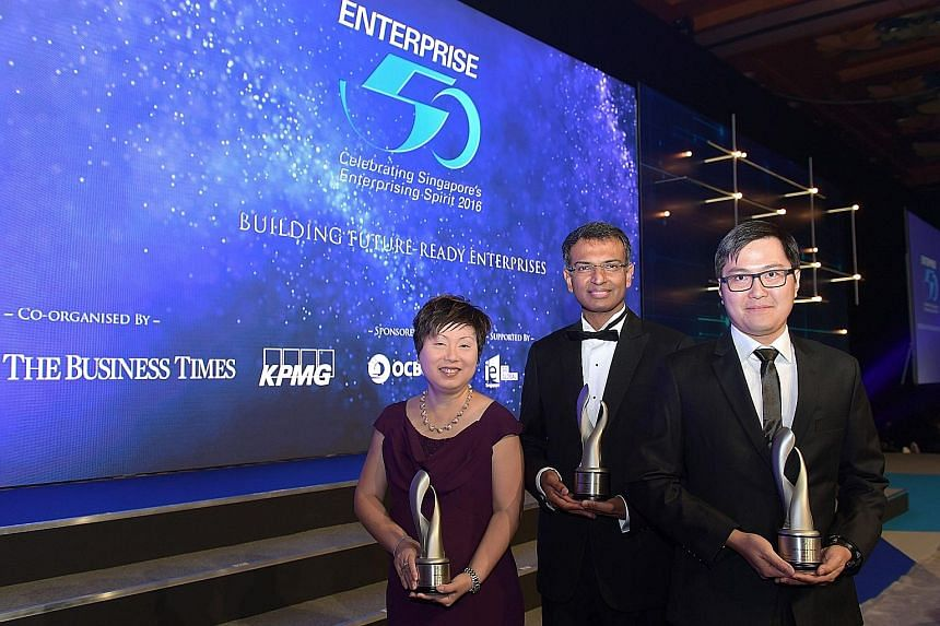 Representing the winning firms were (from left) UEMS general manager Tan Cheh Tian (second runner-up), BLPL managing director Mahesh Sivaswamy (winner) and Garena vice-president Jason Ng (first runner-up).