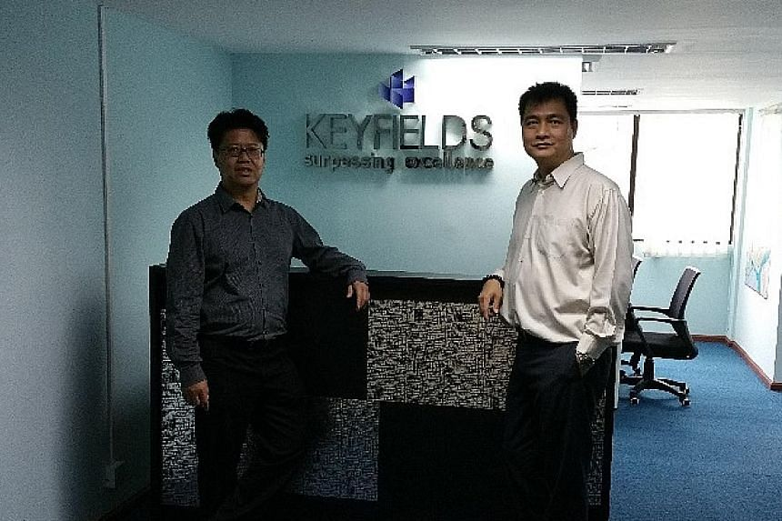 Chief executive of logistics firm Keyfields, Mr Tan (in glasses), moved into Myanmar after feeling his firm lost out from entering the Shanghai market late.