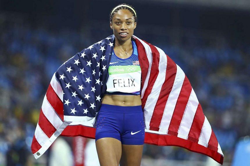 Allyson Felix celebrates gold for the US in the women's 4 x 400m Relay Final at the Rio Olympics in August 2016.