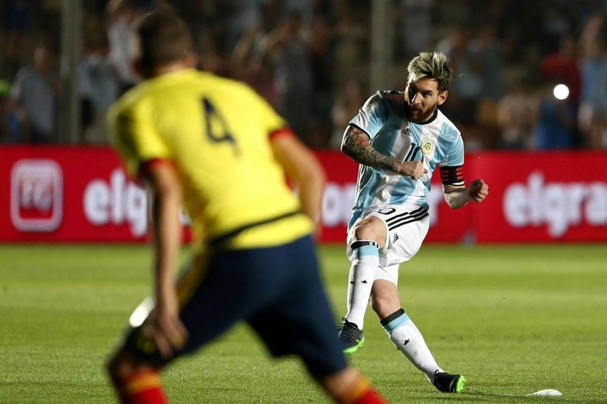 Argentina's Lionel Messi shoots to score a goal against Colombia in their 2018 World Cup Qualifiers match.