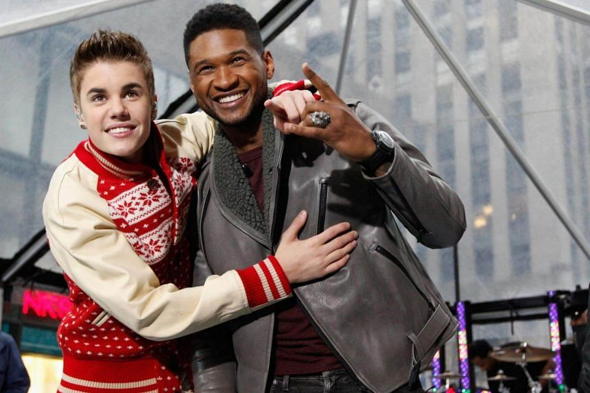 Singers Justin Bieber and Usher pose together after performing on NBC's Today show in New York on Nov 23, 2011.