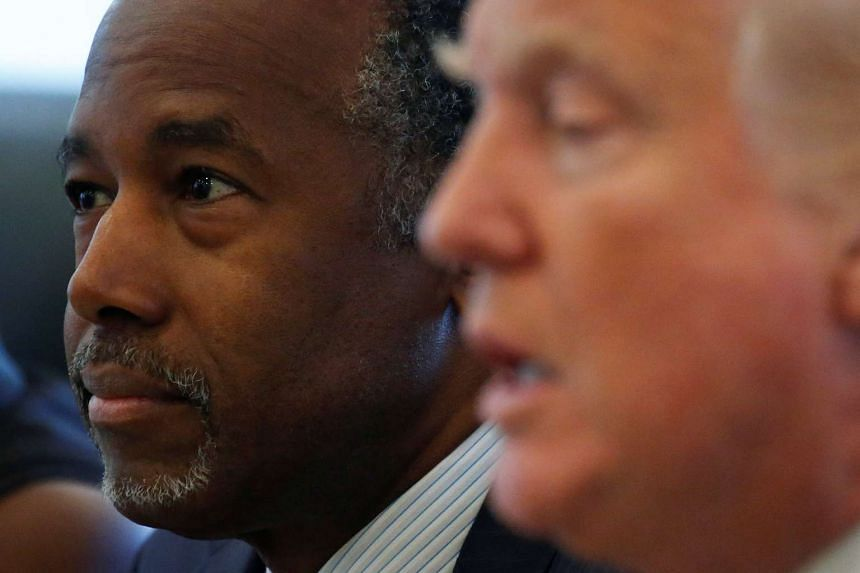 Dr Ben Carson (left) and Mr Donald Trump at an event at Trump Tower in New York in August 2016.