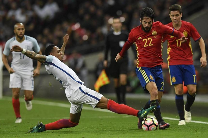 Spain's Isco (right) vies for the ball against England's Danny Rose during the International friendly soccer match between England vs Spain, Wembley Stadium in London, Britain on Nov 15, 2016.