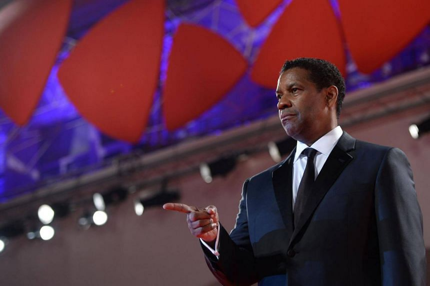 Actor Denzel Washington attends the premiere of the movie The Magnificent Seven.