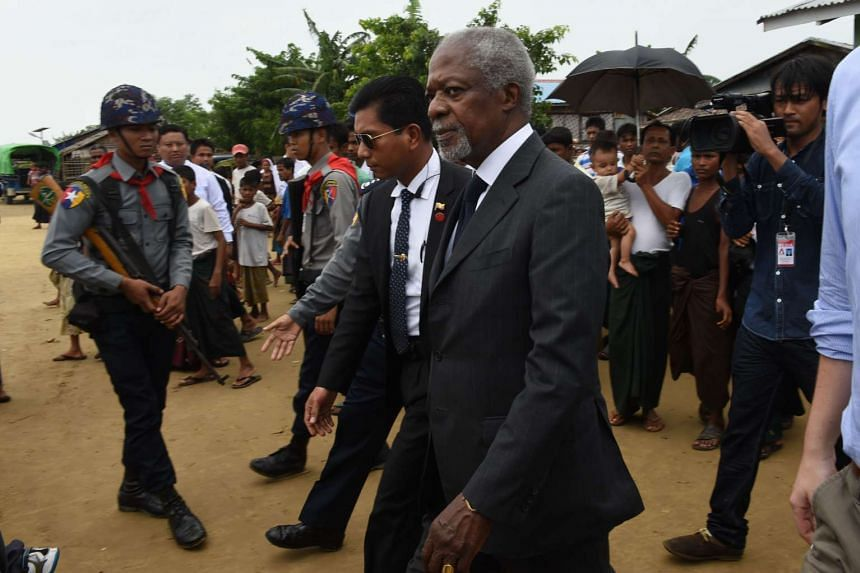 Former UN secretary general Kofi Annan (centre), escorted by police and security, departs following a meeting with Rohingya Muslims at Thet Kay Pyin camp for displaced Rohingya families.