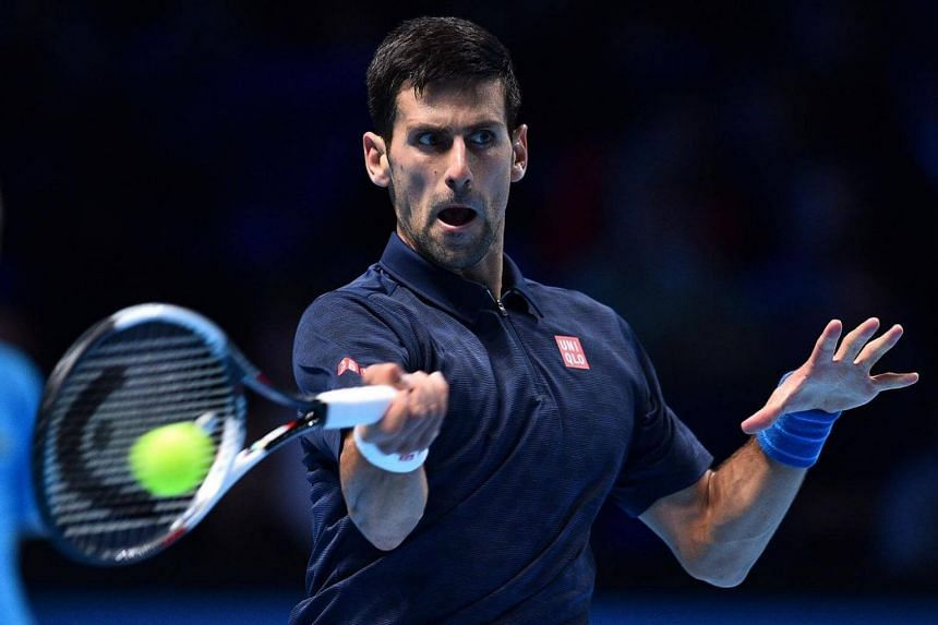 Serbia's Novak Djokovic returns to Canada's Milos Raonic during their men's singles match on day three of the ATP World Tour Finals tennis tournament in London on Nov 15, 2016.