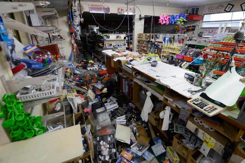 Supplies are scattered inside a hardware store in Waiau town, some 80 km to the south of Kaikoura, on Nov 16, 2016.