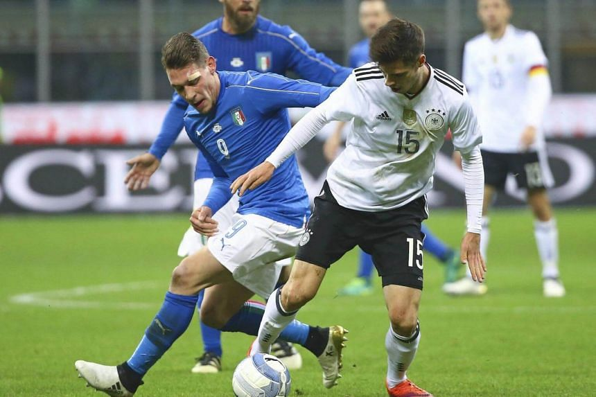Italy's Andrea Belotti in action against Germany's Julian Weigl during their international friendly match at San Siro Stadium in Milan, Italy on Nov 15, 2016.