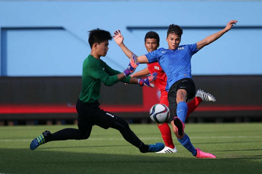 Singapore Under-16's Ikhsan Fandi (in blue) attempting to score against their U-15 counterparts at Jalan Besar Stadium on Aug 16, 2016.