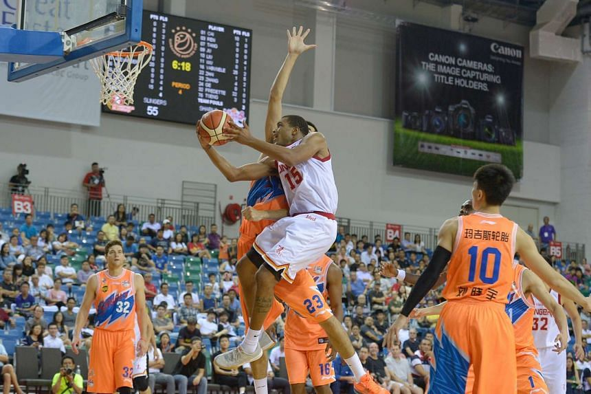 Singapore Slingers' Xavier Alexander attempts to score against the Shanghai Sharks during their Merlion Cup match in September 2016.