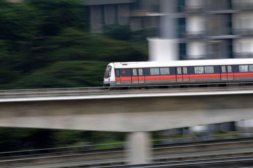 An SMRT train travelling near Jurong East station.