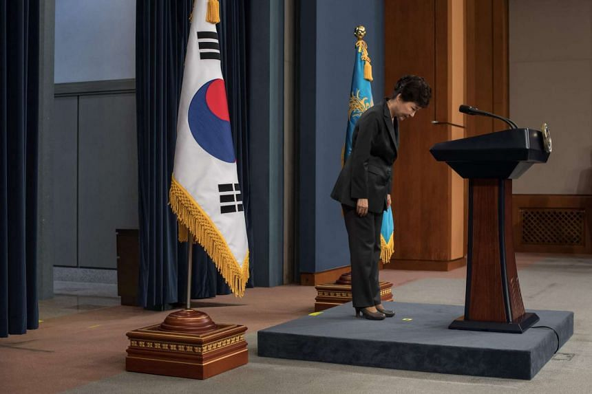 South Korea's President Park Geun Hye bows prior to delivering an address to the nation at the presidential Blue House in Seoul on Nov 4, 2016.