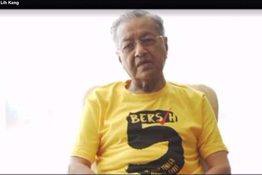 Former Malaysian Prime Minister Mahathir Mohamad wore a yellow Bersih 5 tee-shirt in a video clip to urge Malaysians to protest this Saturday (Nov 19).