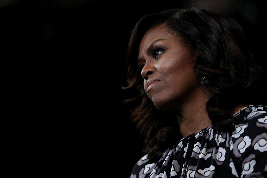 Michelle Obama looks on as Hillary Clinton speaks during a campaign rally at Wake Forest University on Oct 27, 2016.