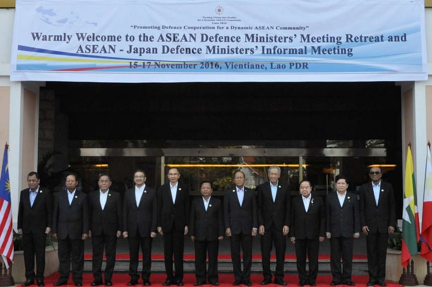 Minister for Defence Dr Ng Eng Hen (fourth from right) with his counterparts at the Asean Defence Ministers' Meeting Retreat.