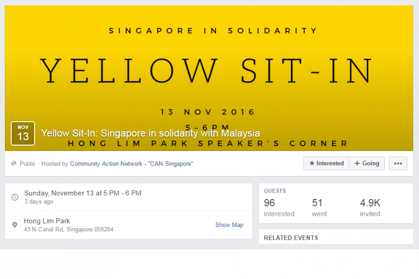 During the Yellow Sit-In event, the 15 or so participants laid a Singapore flag and a Malaysian flag on mats.