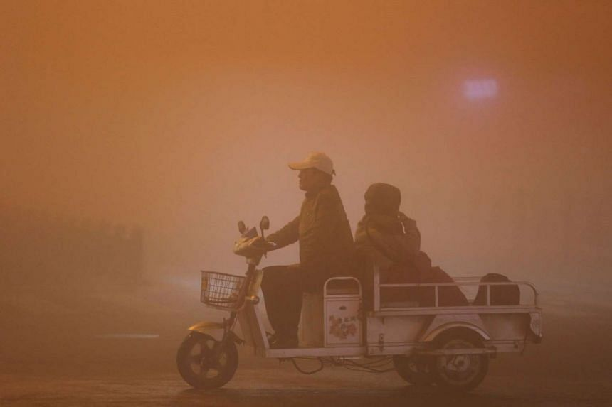 Heavy smog in Lianyungang, Jiangsu province, on Sunday. Experts have warned residents in northern China to brace themselves for more smoggy weather in the coming weeks as La Nina weather conditions coincide with the start of the winter heating season in t