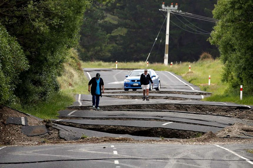 Residents near the town of Ward on New Zealand's South Island surveying the damage to State Highway One on Monday.
