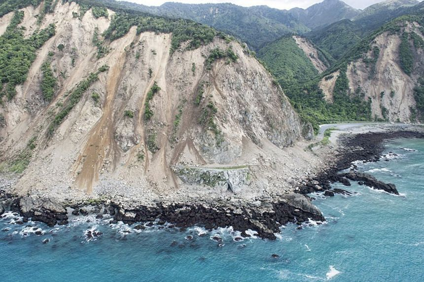 Landslides block transport links along the coast, as shown in an aerial picture from the Royal New Zealand Air Force.